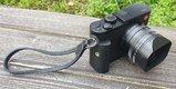 Leica Q, grip, bateria, UV filter, putko na ruku, TOP stav