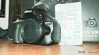 Nikon D5100 telo (s malou chybou) + stativ + prislusenstvo