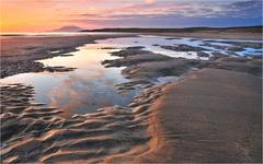 Zapad slnka na White Strand