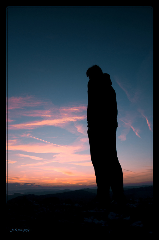 Man looking at the sunrise