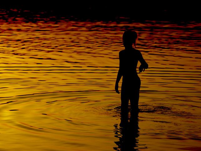 pri západe vo vode