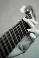 fingers on guitar ties..