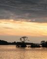 Západ slnka pri jazierku