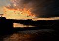 Západ slnka nad potokom