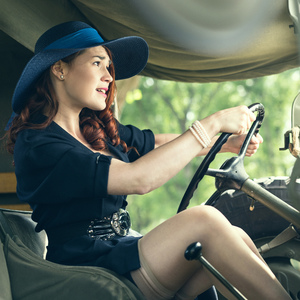 Vintage girl driving jeep
