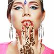 woman face henna on hand