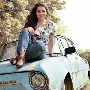 Old car, young woman