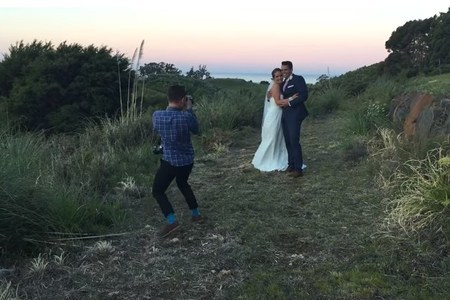 Hilarious wedding photographer making couple laugh