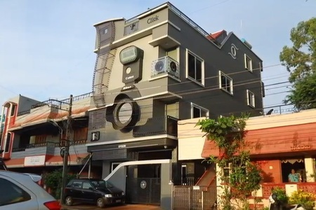 Man Obsessed With Cameras Lives In Camera Shaped House